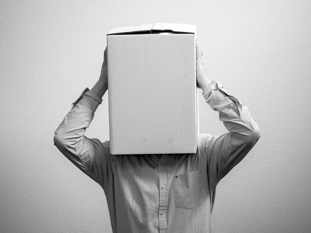 person-with-box-covering-head