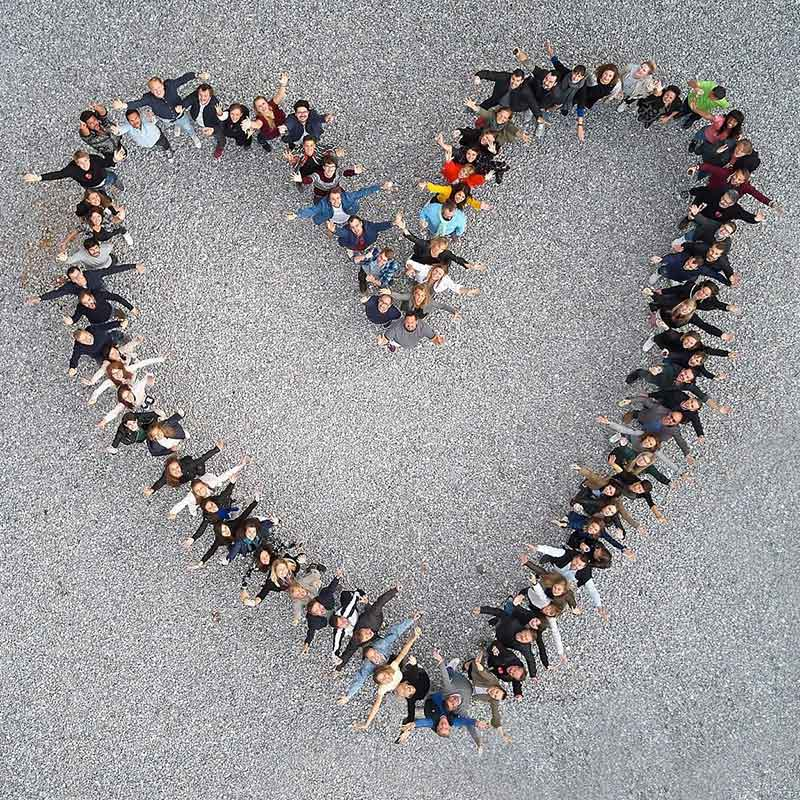 social-lab-employees-forming-a-heart